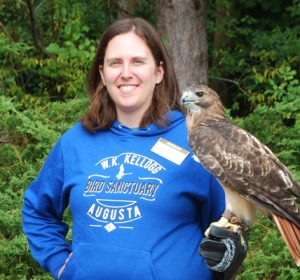 Sara DePew-Bӓby and Red-tailed Hawk