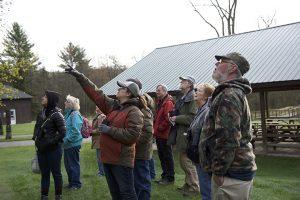 Group identifing birds during Birds and Coffee Walk program