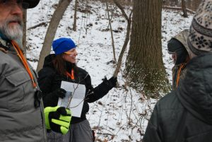 Dr. Danielle Zoellner leading a winter tree ID hike