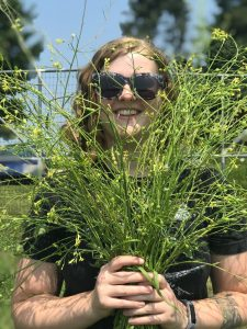Image of Ava Garrison holding a plant